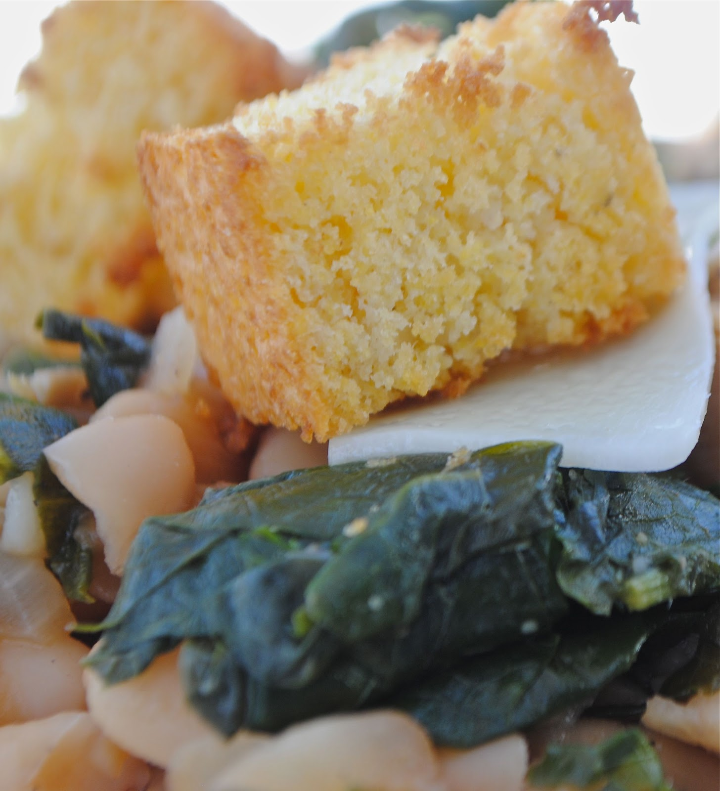 enjoying a second helping beans and greens with cornbread croutons