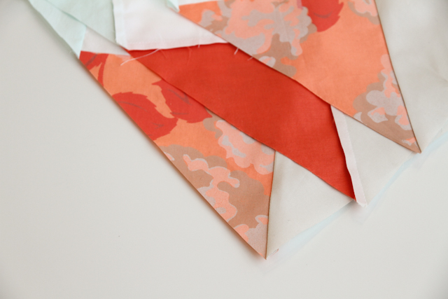 edges of pieced modern mint and coral aztec quilt top   by Lovely and Enough
