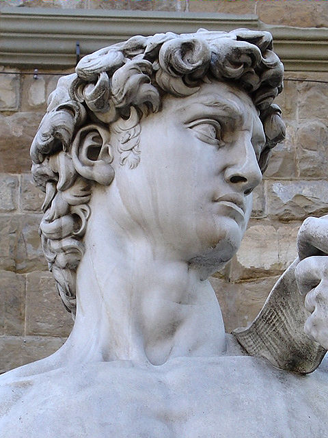 Close-up view of David's chiseled features on the replica standing in front of the Palazzo Vecchio in Piazza della Signoria in Florence, Italy.