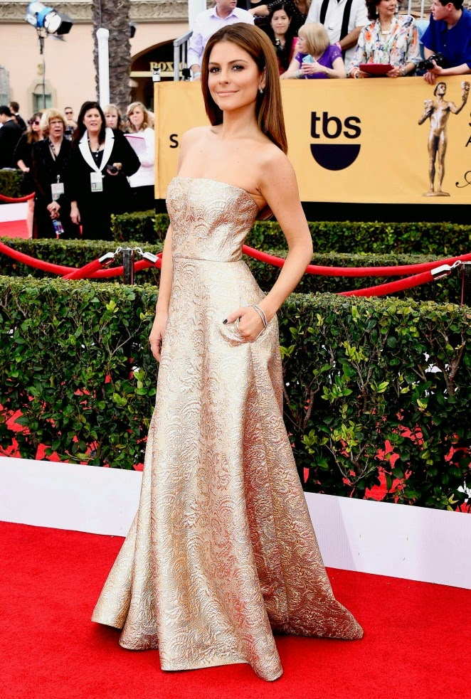 Maria Menounos dazzles in a strapless gold gown at the 21st Annual SAG Awards in LA