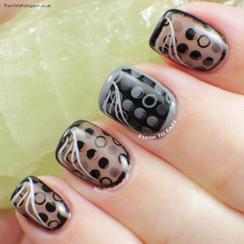 Monochromatic dotted and outlined nail art.