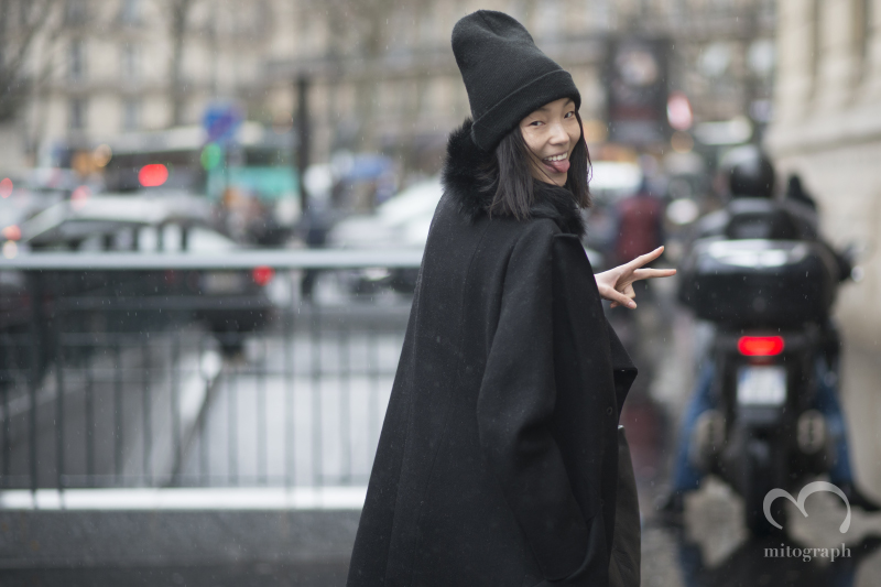 Model Xiao Wen Ju leaves fashion show during Paris Fashion Week 2014 Fall Winter PFW