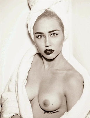 Miley Cyrus goes topless for Vogue Germany Magazine March 2014 Photos