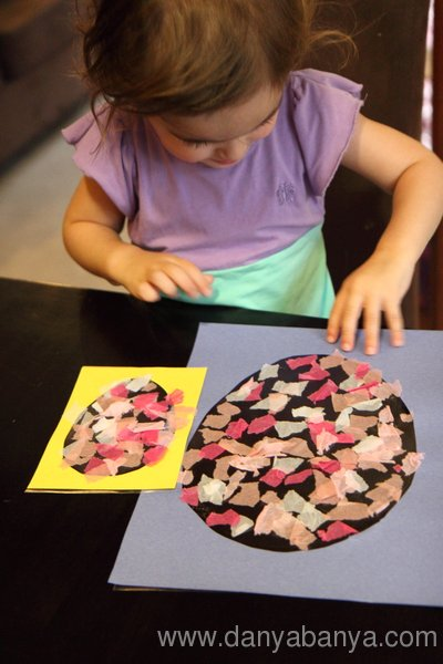 Toddler making Stained Glass Easter Egg with ripped up tissue paper