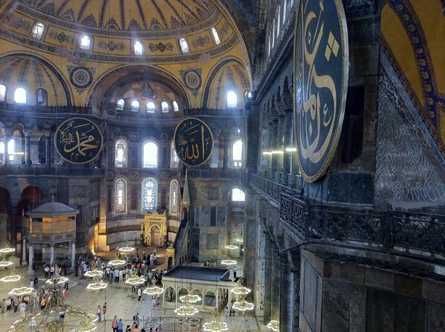 """Hagia Sophia, also known as the """"Church of the Holy Wisdom"""", is located in Istanbul, Turkey. The church has been turned into a museum now. The church was made by the first Christian Emperor – Constantine the Great, who is also known as the founder of Constantinople. This church is the greatest church out of the many churches he built in many cities. The church which stands today is nothing of the original one due to the destruction that occurred through time. When the original Hagia Sophia was destroyed, it was rebuilt by Theodosius the Great, but sadly it was burnt down again in the Nika riots of 532. Some of the remains can still be seen after deep excavations."""