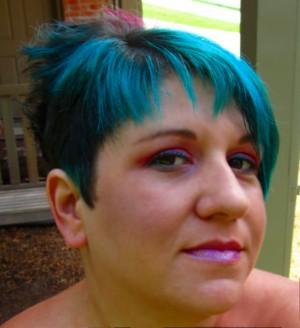 Black nail polish and lip gloss: New haircut & Makeup