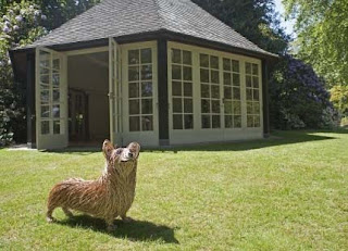 Summer House exterior with wicker corgi