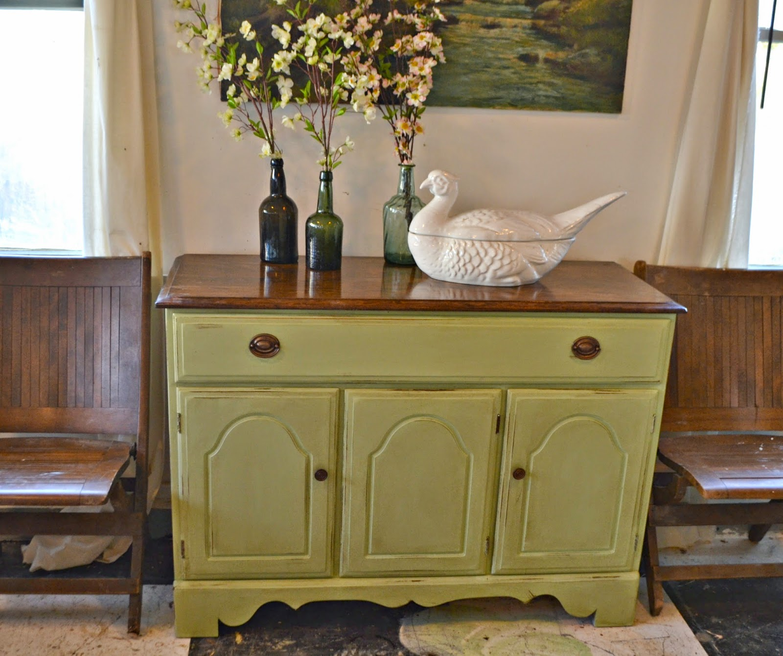 heir and space: a temple stuart sideboard in pale green