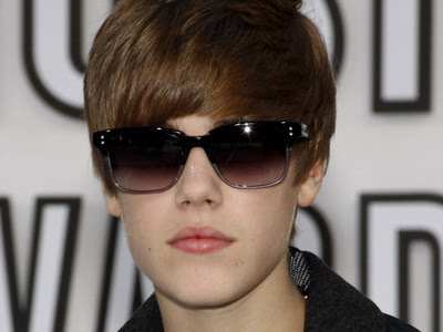 justin bieber phone number real 2011. justin bieber face 2011.