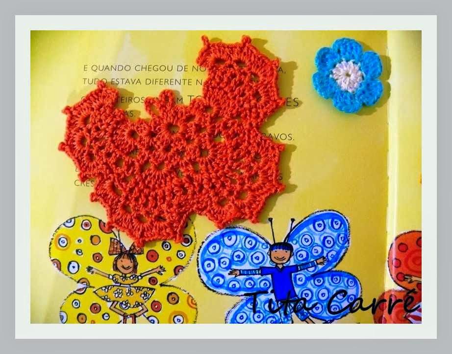 Borboleta e flores em crochet