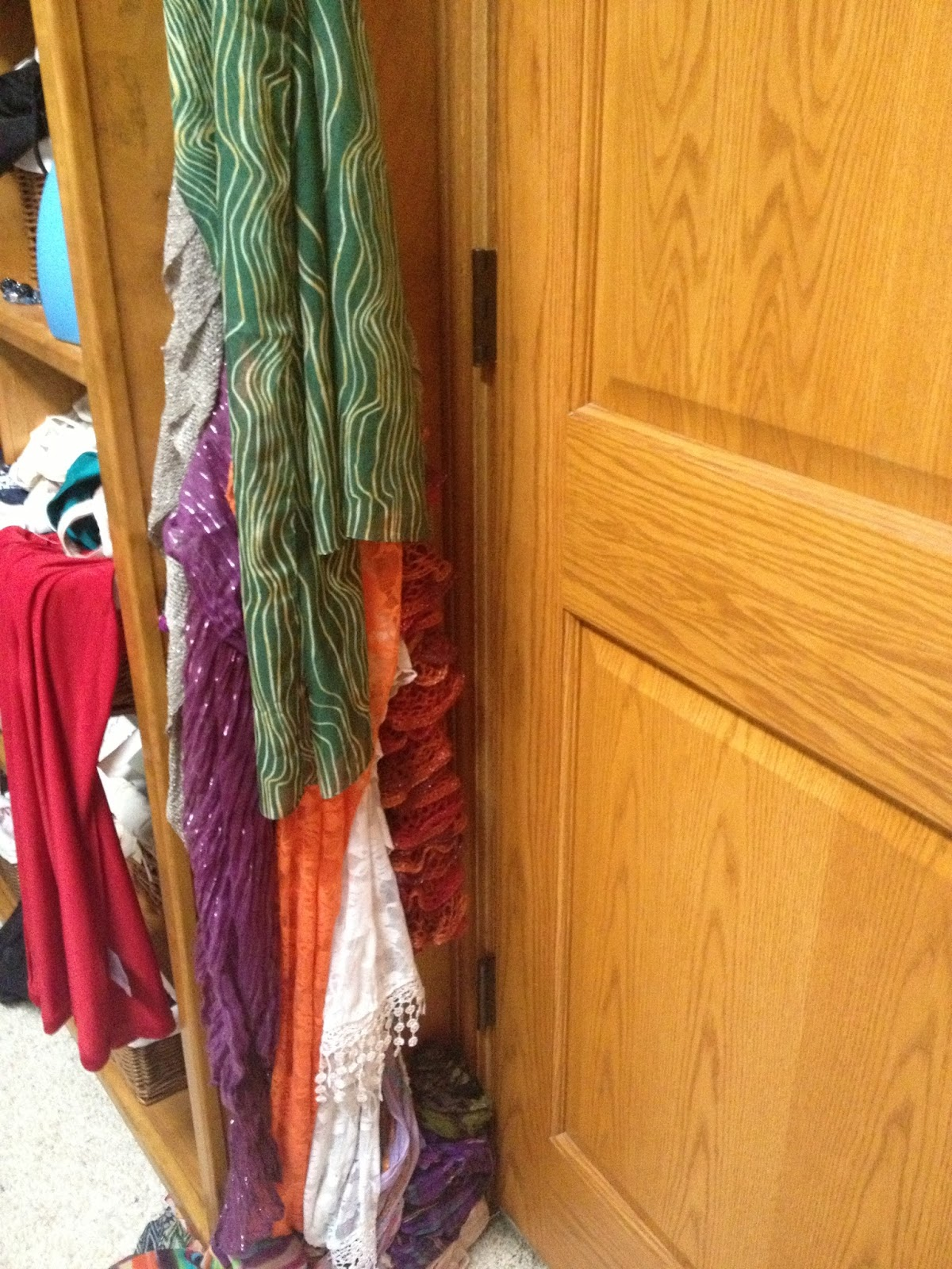 Organize your scarves with shower curtain rings and a hanger. DIY Scarf  Organizer