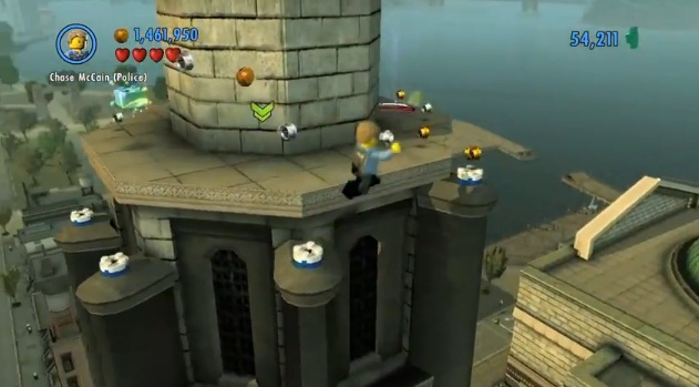 Chase McCain on rooftop of building in Wii U version of Lego City: Undercover