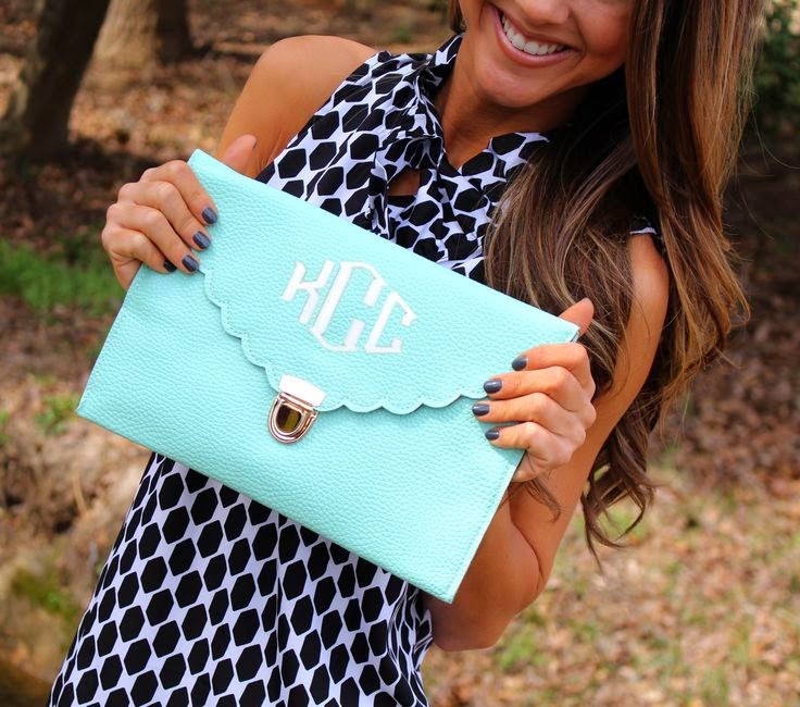 https://marleylilly.com/product/monogrammed-scalloped-luxe-cross-body-clutch/