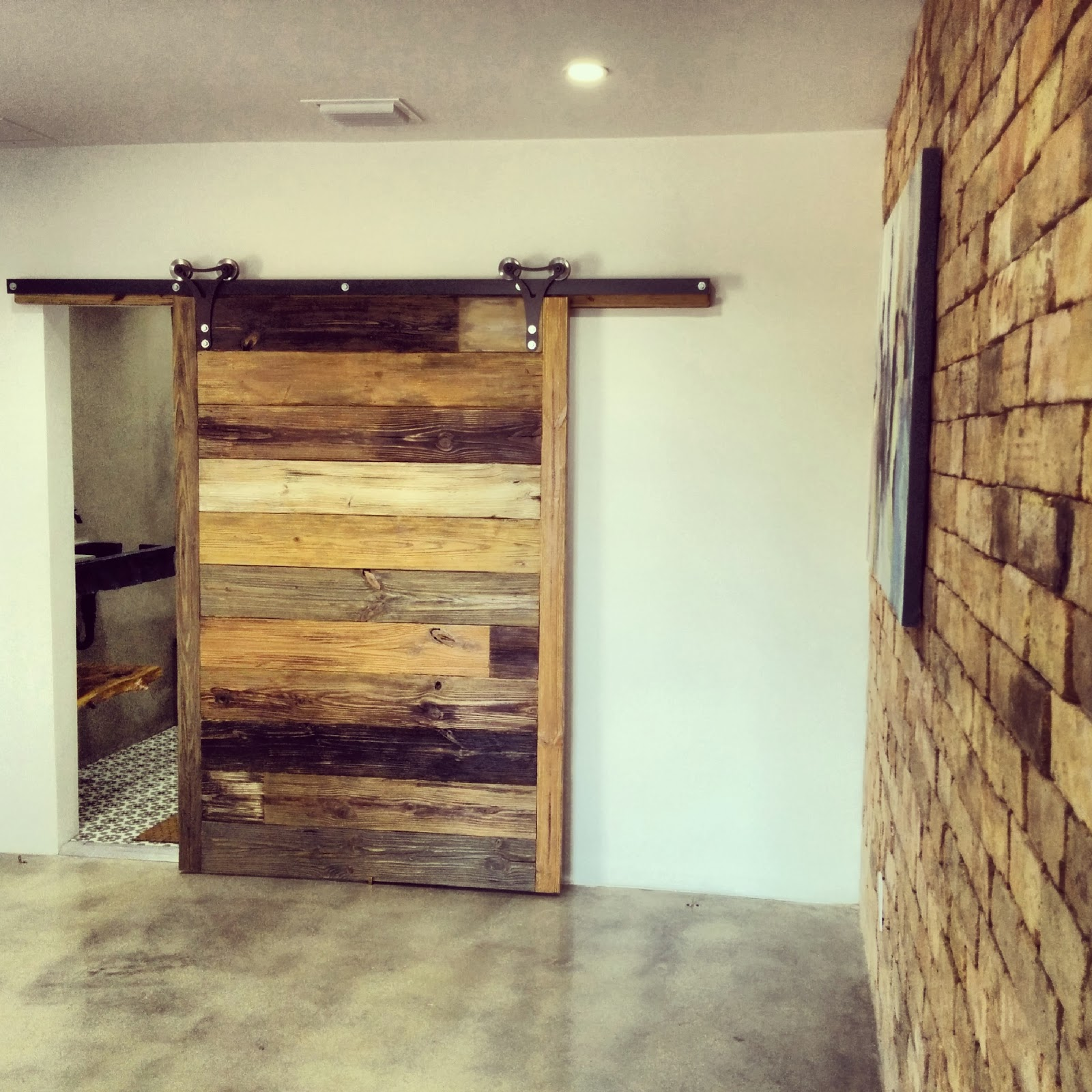 The conversation piece workshop loft sliding barn door for Unique interior door ideas