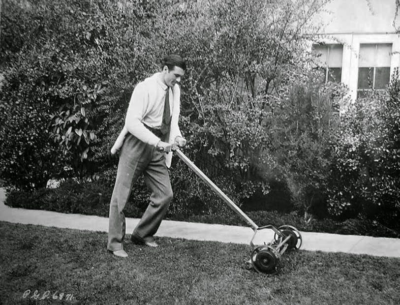 Gary Cooper cutting his grass.