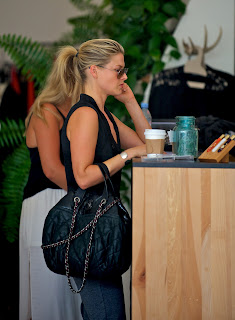 Ali Larter  waiting to pay her bill
