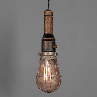 Caged Lightbulb Fixture via Rejuvenation as seen on linenandlavender.net