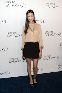 Odette Annable in a short black skirt at Samsung Galaxy S III Launch in Los Angeles