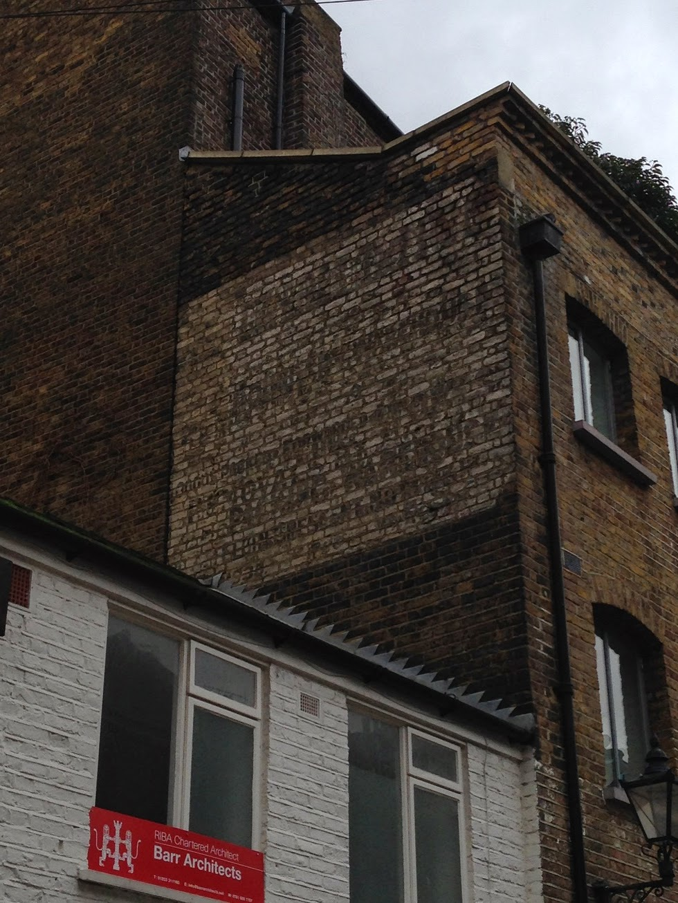 Ghost sign in Powis Mews, London W2