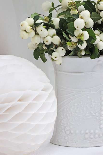 White Snowberries in white vase