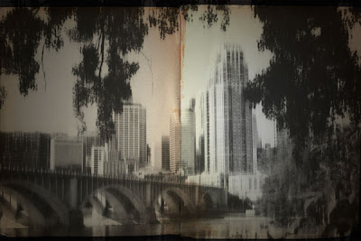 Photoshopped image of the Minneapolis skyline near the stone arch bridge.