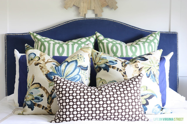 Guest Bedroom with A Blue Headboard and Designer Pillows
