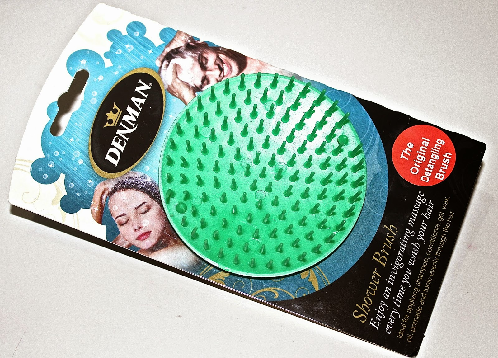 picture of Denman Detangling hair brush and packaging