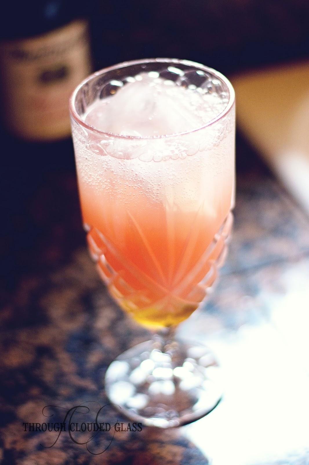 Watermelon lemonade spritzer non alcoholic summer drink recipe through clouded glass - Lemonade recipes popular less known ...