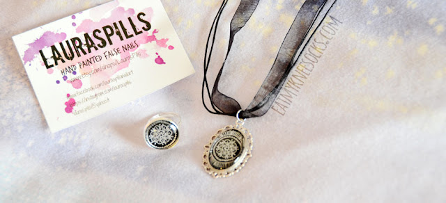 I'm kicking off the new year with a new review of a store that I've never tried before: LaurasPills! This Etsy shop features handmade and hand-painted false nails, necklaces, rings, and earrings, with beautiful and one-of-a-kind designs. I received a silver necklace and matching ring to review.