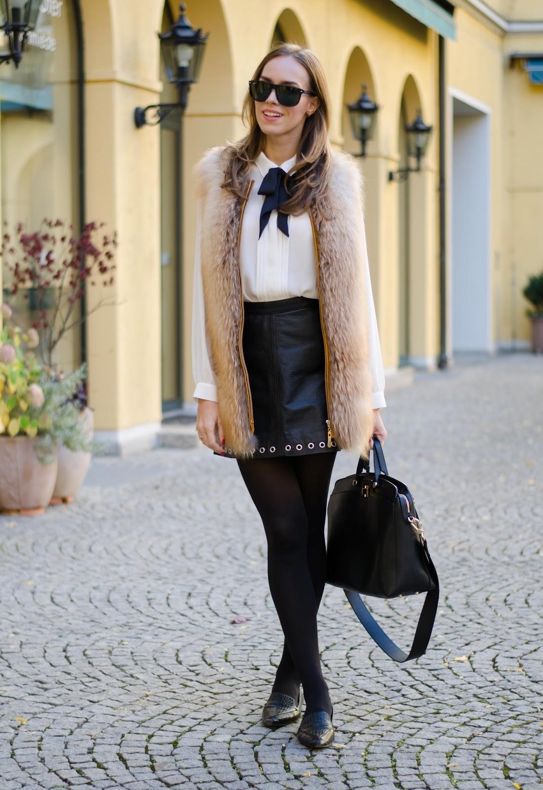kristjaana mere red gold fox fur vest black leather skirt white bow tie shirt fashion