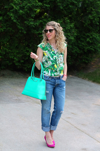Boyfriend jeans, tropical print top, and pink heels