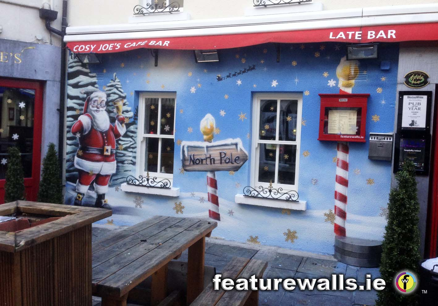 This is a very christmassy mural featurewalls ie hand painted