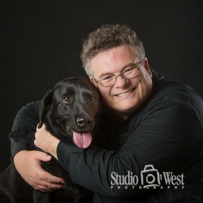photo of black dog on black background - Studio 101 West Photography