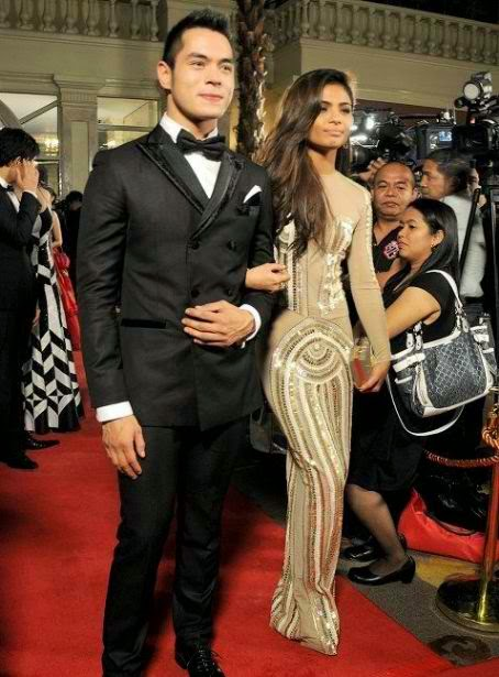 "Kapuso sexy actress and singer Lovi Poe admits having a romantic relationship with the Kapamilya's hunk actor Jake Cuenca since they were rumored to be a couple after they starred a role together in GMA's 2011 film ""My Neighbor's Wife"","