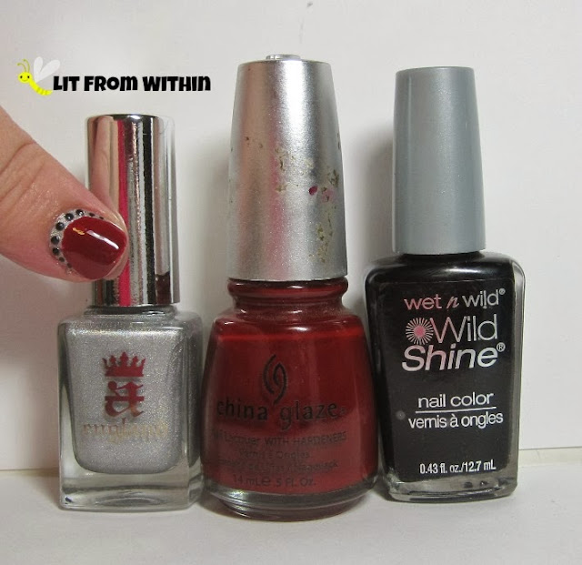 Bottle shot:  A-England Encore Margot, China Glaze Phat Santa, Wet 'n Wild Black Creme.