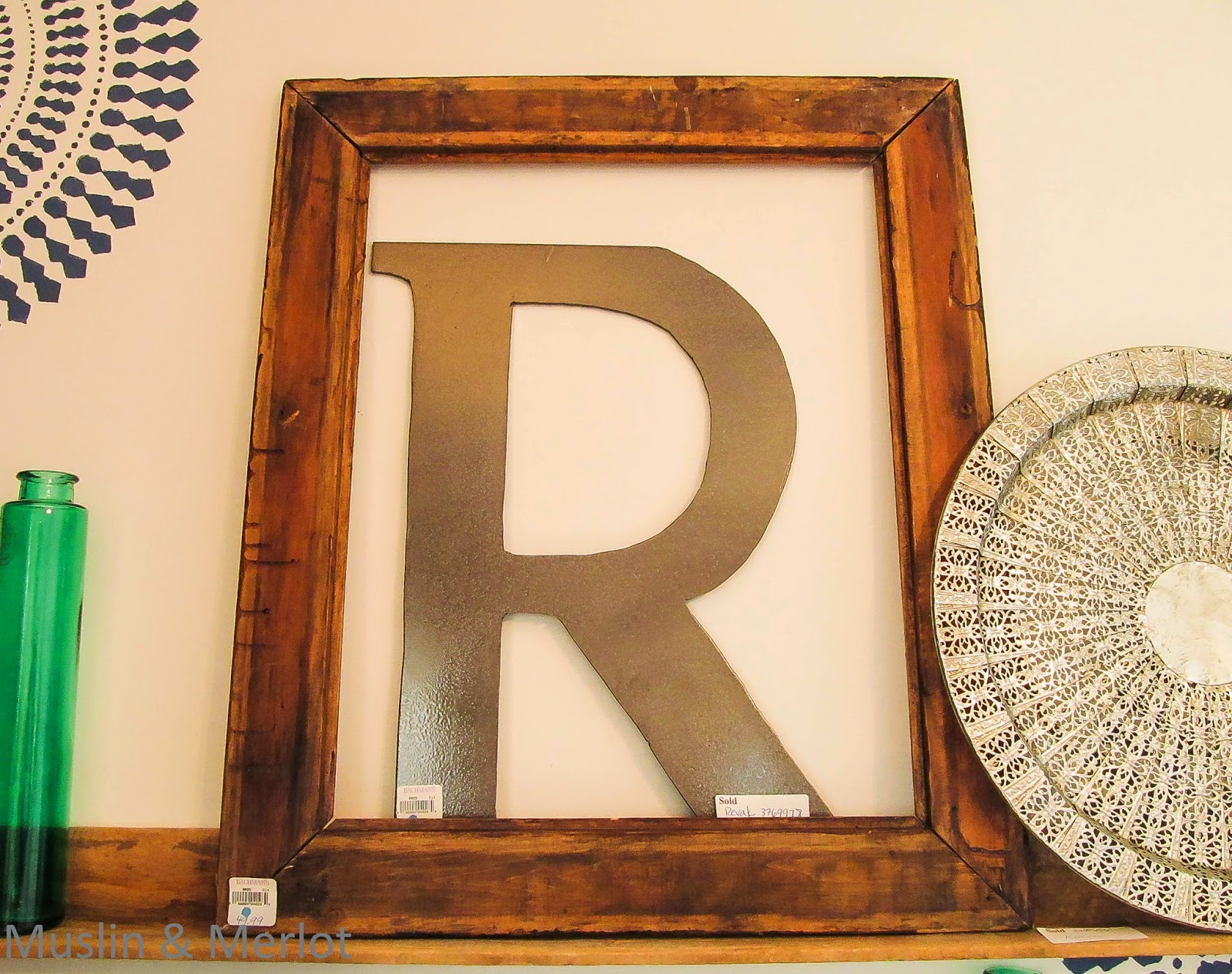 Metal letter and wood frame decor.