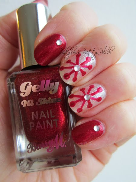 Red-sparkle-snowflake-nail-art.jpg