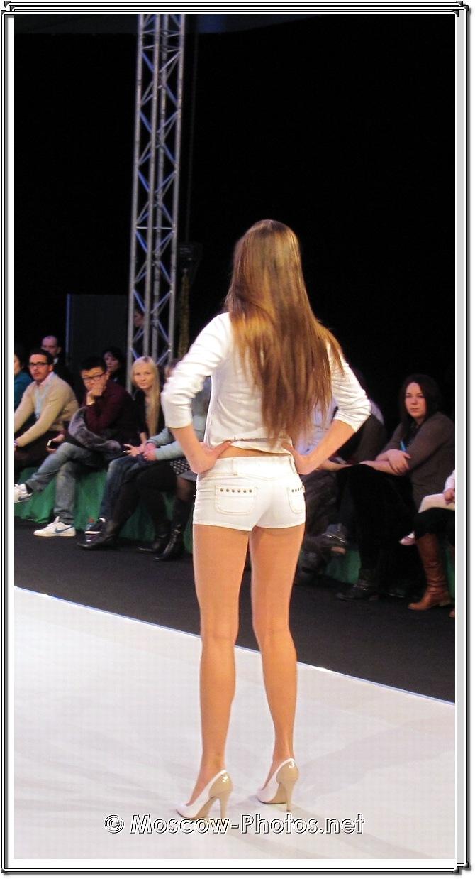 Model in White Denim Mini Shorts