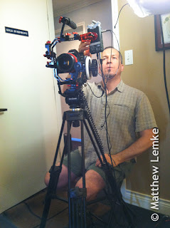 Videographer preparing camera for a video shoot in Austin, Texas