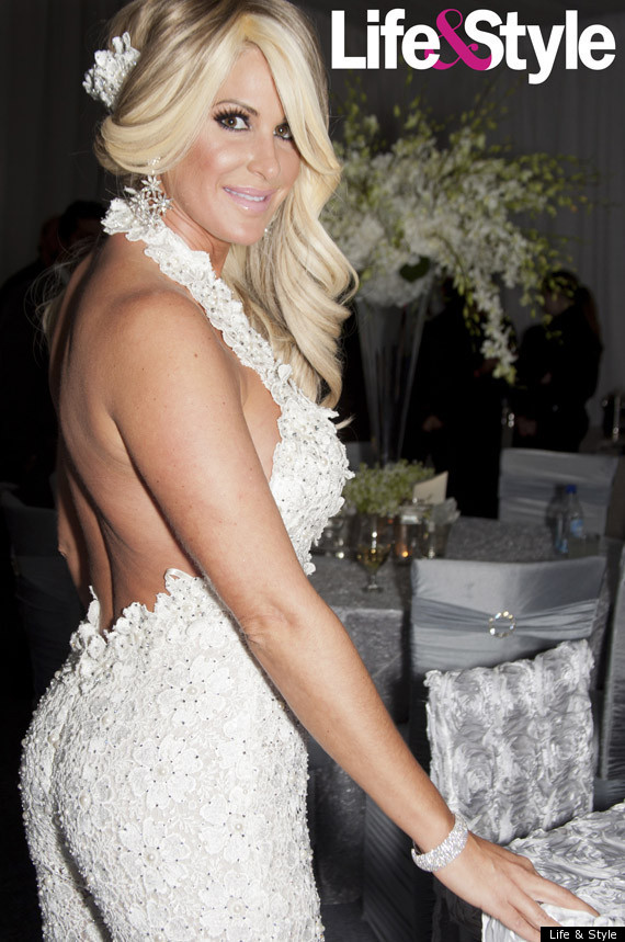 Check out Kim in her white jumpsuit. I can see how this would be good ...