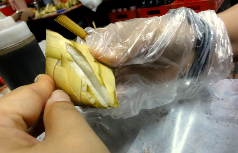 Eat Food in Cebu with a Cellophane Glove