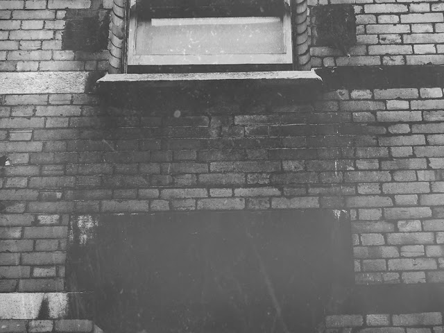Brick wall with windows in black and white