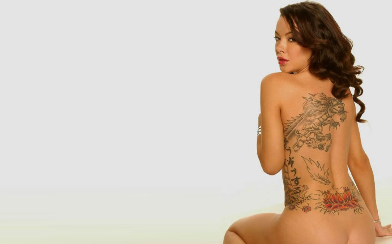 http://1.bp.blogspot.com/-K-gLpKt9Sg0/Tv7dy9au7RI/AAAAAAAAASM/XyDyDQ7udVk/s1600/tattoos_girls_back_dragon_tattoo_taokaka_backview_natalia_cruz_desktop_1440x900_wallpaper-136023.jpeg