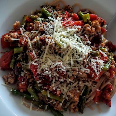 Sun-dried Tomato Olive and Asparagus Pasta:  Sun-dried tomatoes, olives, asparagus and Italian sausage in a chunky pasta sauce served over whole wheat pasta and topped with parmesan.