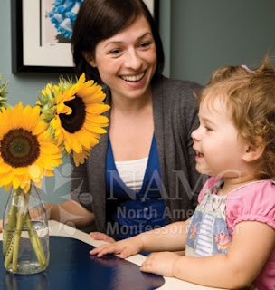 NAMC montessori teacher and girl look at flowers common montessori teacher common worries