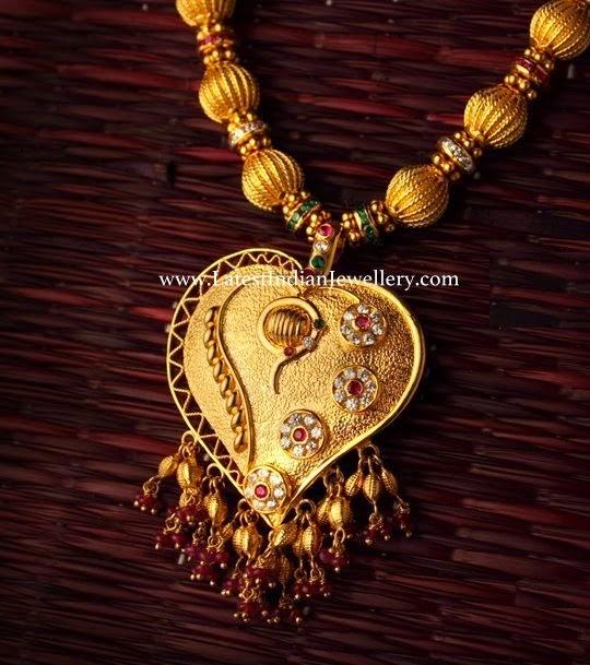 gold balls haram heart pendant