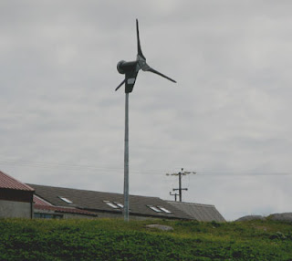 Proven turbine chugging quietly away at the back of the community co-op shop, island of Eriskay, Scotland