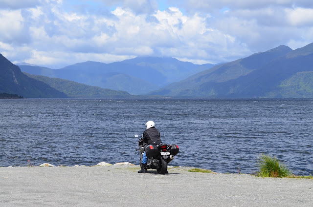 A lone biker spends some time in solitary contemplation, Arthur's Pass, New Zealand