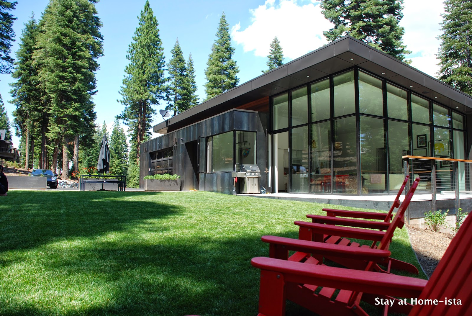 Love this house! The metal and glass are so modern, but it's in the forest!