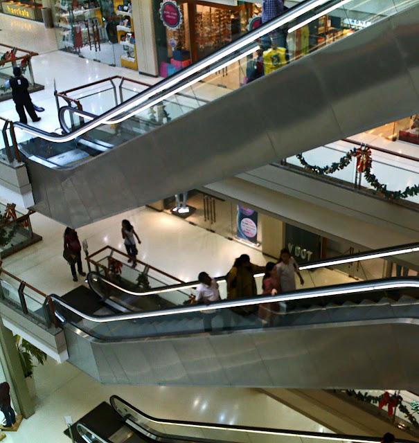 people on the escalators